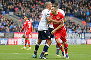 MK Dons defender Antony Kay held by Bolton Wanderers midfielder Darren Pratley  during the Sky Bet Championship match between Bolton Wanderers and Milton Keynes Dons at the Macron Stadium, Bolton, England on 23 January 2016. Photo by Simon Davies.