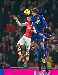 LONDON, ENGLAND - Saturday, November 22, 2014: Arsenal's Kieran Gibbs in action against Manchester United's Marouane Fellaini during the Premier League match at the Emirates Stadium. (Pic by David Rawcliffe/Propaganda)