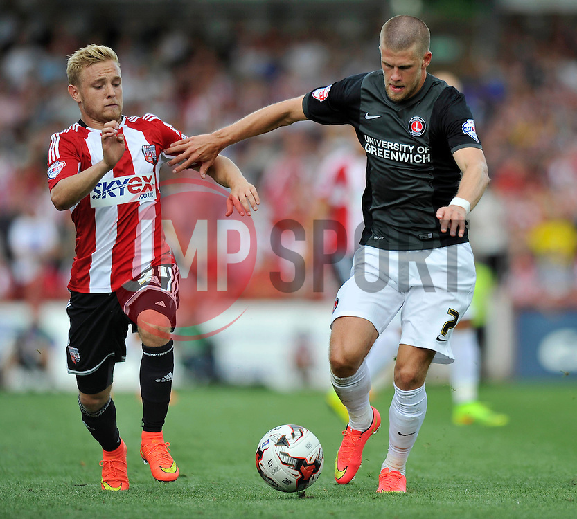 Charlton Athletic's Johann Guomundsson in possession - Photo mandatory by-line: Patrick Khachfe/JMP - Mobile: 07966 386802 09/08/2014 - SPORT - FOOTBALL - Brentford - Griffin Park - Brentford v Charlton Athletic - Sky Bet Championship - First game of the season