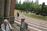 Akira Iwanaga (on right, foreground) and Tsutomu Yamaguchi (on left, rest at a part of Urakami Cathedral now standing as a memorial to epicentre of the Nagasaki Atomic bombing blast on 9th August 1945. Photographed in Nagasaki, Japan,  Tuesday May 24th 2005. Both men were in Hiroshima on the day of the first atomic bombing, 6th Aug. 1945, and also in Nagasaki three days laeter on the day of the second atomic bombing of Japan by US Military.