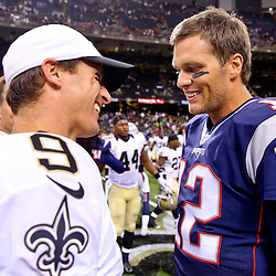 Aug 22, 2015; New Orleans, LA, USA; New England Patriots quarterback Tom Brady (12) talks to New Orleans Saints quarterback Drew Brees (9) following a preseason game at the Mercedes-Benz Superdome. The Patriots defeated the Saints 26-24. Mandatory Credit: Derick E. Hingle-USA TODAY Sports
