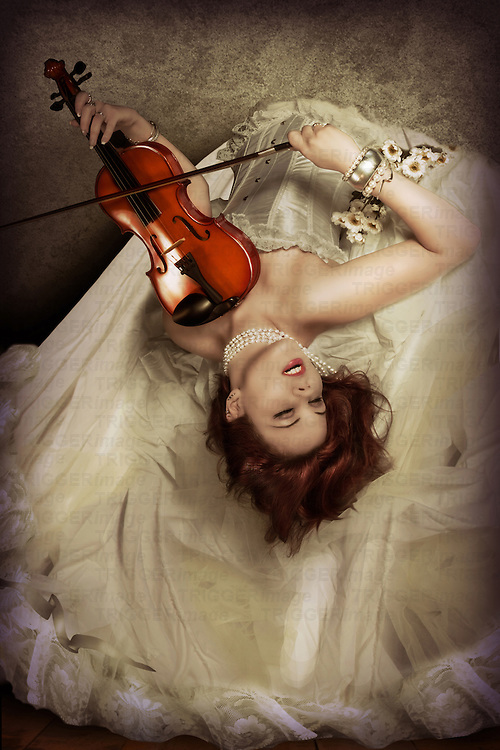 Girl playing violin with passion