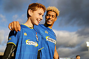 AFC Wimbledon striker Lyle Taylor (33) with mascot during the EFL Sky Bet League 1 match between AFC Wimbledon and Peterborough United at the Cherry Red Records Stadium, Kingston, England on 12 November 2017. Photo by Matthew Redman.