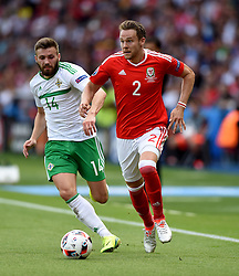 Chris Gunter of Wales battles for the ball with,  Stuart Dallas of Northern Ireland  - Mandatory by-line: Joe Meredith/JMP - 25/06/2016 - FOOTBALL - Parc des Princes - Paris, France - Wales v Northern Ireland - UEFA European Championship Round of 16