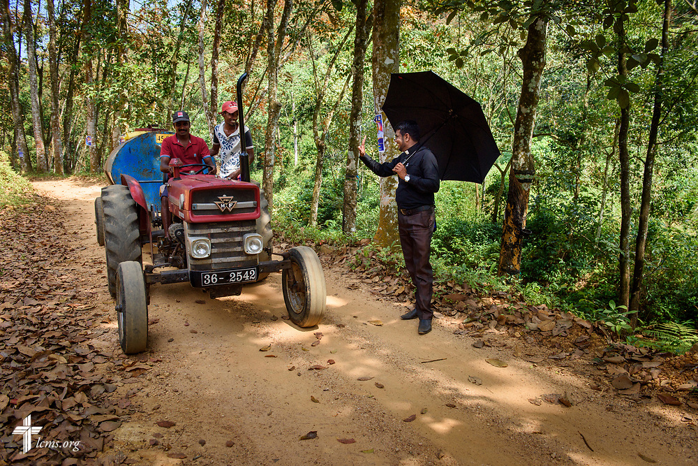 The Rev. P. Gnanakumar waves to passing workers on the Eila rubber plantation in the Sabaragamuwa Province of Sri Lanka on Saturday, Jan. 20, 2018. LCMS Communications/ Erik M. Lunsford