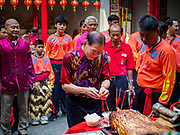 05 FEBRUARY 2019 - BANGKOK, THAILAND:  Members of Canton Shrine in Bangkok present offerings during Chinese New Year celebrations at the shrine. Chinese New Year celebrations in Bangkok started on February 4, 2019, although the city's official celebration is February 5 - 6. The coming year will be the Year of the Pig in the Chinese zodiac. About 14% of Thais are of Chinese ancestry and Lunar New Year, also called Chinese New Year or Tet is widely celebrated in Chinese communities in Thailand.      PHOTO BY JACK KURTZ