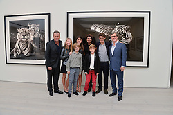 Left to right, DAVID YARROW, JADE YARROW, CAMERON YARROW, KATE OFFORD, ELIZABETH OFFORD, ROBBIE OFFORD, TOM OFFORD,  & ? at a private view of photographs by wildlife photographer David Yarrow included in his book 'Encounter' held at The Saatchi Gallery, Duke of York's HQ, King's Road, London on 13th November 2013.