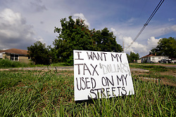 20 August 2015. New Orleans, Louisiana. <br /> Hurricane Katrina revisited. <br /> A protest sign planted in an empty lot in the still devastated lower 9th Ward. <br /> Photo credit©; Charlie Varley/varleypix.com.