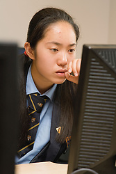 Secondary school student concentrating on a computer in an ICT lesson,