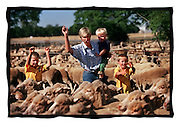 csz981121.001.005.jpg..Farmer Lu Hogan with her kids Angus 8, Hugh 3 and Max 6, pic by craig sillitoe, news melbourne photographers, commercial photographers, industrial photographers, corporate photographer, architectural photographers, This photograph can be used for non commercial uses with attribution. Credit: Craig Sillitoe Photography / http://www.csillitoe.com<br /> <br /> It is protected under the Creative Commons Attribution-NonCommercial-ShareAlike 4.0 International License. To view a copy of this license, visit http://creativecommons.org/licenses/by-nc-sa/4.0/.