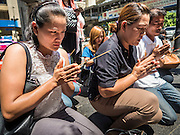 19 AUGUST 2015 - BANGKOK, THAILAND: Thais who lost family members in the terror bombing of Erawan Shrine pray during a memorial at the reopening of the shrine. Erawan Shrine in Bangkok reopened Wednesday morning after more than 20 people were killed and more than 100 injured in a bombing at the shrine Monday, August 17, 2015. The shrine is a popular tourist attraction in the center of Bangkok's high end shopping district and is an important religious site for Thais. No one has claimed responsibility for the bombing.      PHOTO BY JACK KURTZ
