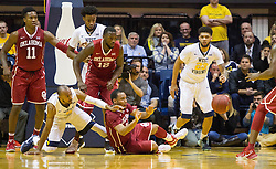 Jan 18, 2017; Morgantown, WV, USA; Oklahoma Sooners guard Jordan Woodard (10) steals the ball and passes to a teammate during the second half against the West Virginia Mountaineers at WVU Coliseum. Mandatory Credit: Ben Queen-USA TODAY Sports