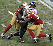 Baltimore Ravens running back Ray Rice, center, is tackled by San Francisco 49ers free safety Dashon Goldson, left and strong safety Donte Whitner during the first quarter of Super Bowl XLVII at the Mercedes-Benz Superdome on February 3, 2013 in New Orleans.  UPI/David Tulis