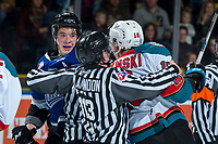 KELOWNA, CANADA - FEBRUARY 12:  Carsen Twarynski #18 of the Kelowna Rockets gets in the face of Ralph Jarratt #4 of the Victoria Royals after a hit on Kole Lind #16 of the Kelowna Rockets on February 12, 2018 at Prospera Place in Kelowna, British Columbia, Canada.  (Photo by Marissa Baecker/Shoot the Breeze)  *** Local Caption ***