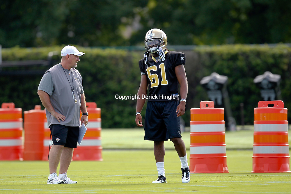 July 29, 2011; Metairie, LA, USA; New Orleans Saints linebacker Nate Bussey (61) talks with special teams coach Greg McMahon during the first day of training camp at the New Orleans Saints practice facility. Mandatory Credit: Derick E. Hingle