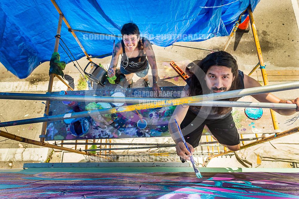 Nicole Salgar and Juan Montoya paint a mural on the exterior of the Kilted Mermaid in Vero Beach on 8/4/2017.