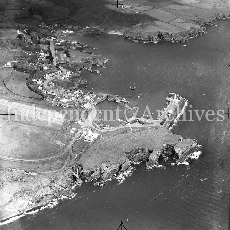 A187 Dunmore East.   20/02/53. (Part of the Independent Newspapers Ireland/NLI collection.)<br /> <br /> <br /> These aerial views of Ireland from the Morgan Collection were taken during the mid-1950's, comprising medium and low altitude black-and-white birds-eye views of places and events, many of which were commissioned by clients. From 1951 to 1958 a different aerial picture was published each Friday in the Irish Independent in a series called, 'Views from the Air'.