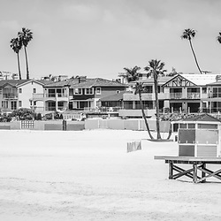 Seal Beach California black and white panorama picture with the beach, lifeguard tower, and oceanfront homes. Seal Beach is in Orange County Southern California in the United States of America.