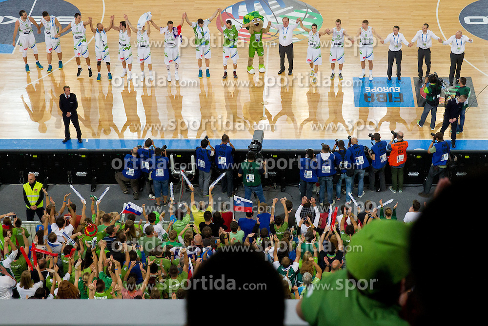 Players of Slovenia celebrate after the basketball match between National teams of Slovenia and Ukraine in 5th Place game at Day 18 of Eurobasket 2013 on September 21, 2013 in Arena Stozice, Ljubljana, Slovenia. (Photo by Vid Ponikvar / Sportida)