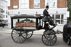 © Licensed to London News Pictures. 29/06/2017. London, UK. The funeral cortege of Grenfell fire victim Tony Disson travels to  Our Lady of the Holy Souls church for a service. Mr Disson is one of only a handful of the 80 victims to have been identified and named so far. Photo credit: Peter Macdiarmid/LNP