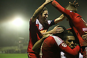 Whitehawk midfielder Sergio Torres congratulates Whitehawk striker Danny Mills after his goal during the The FA Cup 2nd Round Replay match between Whitehawk FC and Dagenham and Redbridge at the Enclosed Ground, Whitehawk, United Kingdom on 16 December 2015. Photo by Phil Duncan.