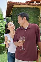Couple drinking wine in garden