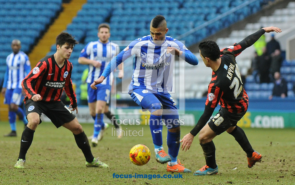 Lewis McGugan of Sheffield Wednesday gets away from 2 Brighton and Hove Albion defenders during the Sky Bet Championship match at Hillsborough, Sheffield<br /> Picture by Richard Land/Focus Images Ltd +44 7713 507003<br /> 14/02/2015
