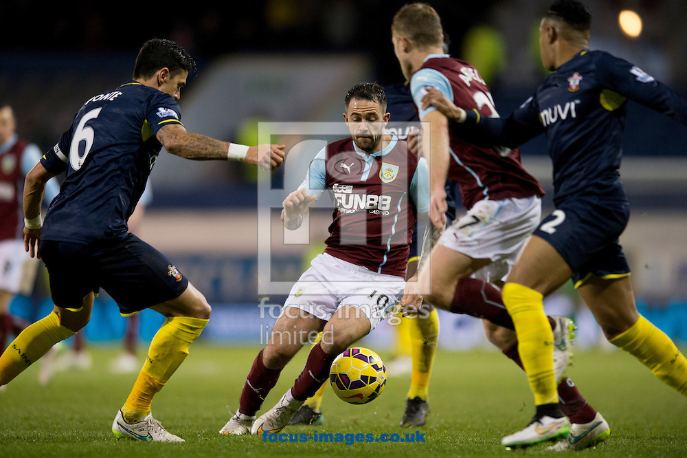 Danny Ings of Burnley (centre) collects the ball in a packed midfield during the Barclays Premier League match at Turf Moor, Burnley<br /> Picture by Russell Hart/Focus Images Ltd 07791 688 420<br /> 13/12/2014
