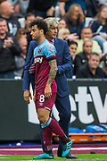 Manuel Pelligrini, Manager of West Ham FC thanking Felipe Anderson (West Ham) after he comes off substituted by Jack Wilshere (West Ham) during the Premier League match between West Ham United and Manchester United at the London Stadium, London, England on 22 September 2019.