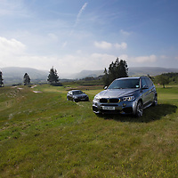 BMW Vehicles that will be used as the Official Ryder Cup cars pictured overlooking the first fairway on the PGA Course at Gleneagles, with Glendevon pictured behind them...11.07.69<br /> Picture by Graeme Hart.<br /> Copyright Perthshire Picture Agency<br /> Tel: 01738 623350  Mobile: 07990 594431