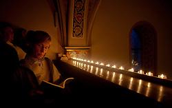 27.05.2011, Pfarre, Kaprun, AUT, Lange Nacht der Kirchen, im Bild Entspannung bei Kerzenschein, eine weibliche Person ließt in einem Buch bei Kerzenlicht, EXPA Pictures © 2011, PhotoCredit: EXPA/ J. Feichter