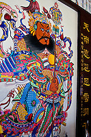 Colourful temple art depicting gods and ancient stories adorn the walls and doors of Thean Hou Temple in Kuala Lumpur.