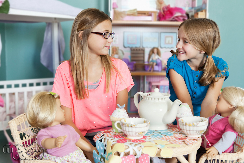 Children and dolls having tea party