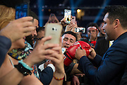 Oscar De La Hoya signs autographs and poses for photos with fans after Canelo Alvarez defeated Liam Smith in front of over 51,000 fans at AT&T Stadium in Arlington, Texas on September 17, 2016.  (Cooper Neill for ESPN)