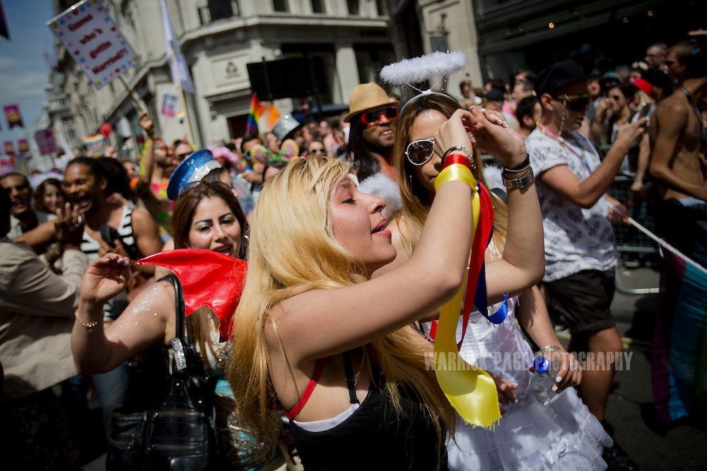 LONDON, UNITED KINGDOM - JUNE 29: Members of the LGBT community dance as they participate in the annual London Pride Parade, on June 29, 2013, in London, Untied Kingdom. The Pride Parade originated in 1971, with this years theme being Love (and marriage), due the increased social and political pressure to make gay marriage law in the UK and several other countries throughout the world. (Photo by Warrick Page)