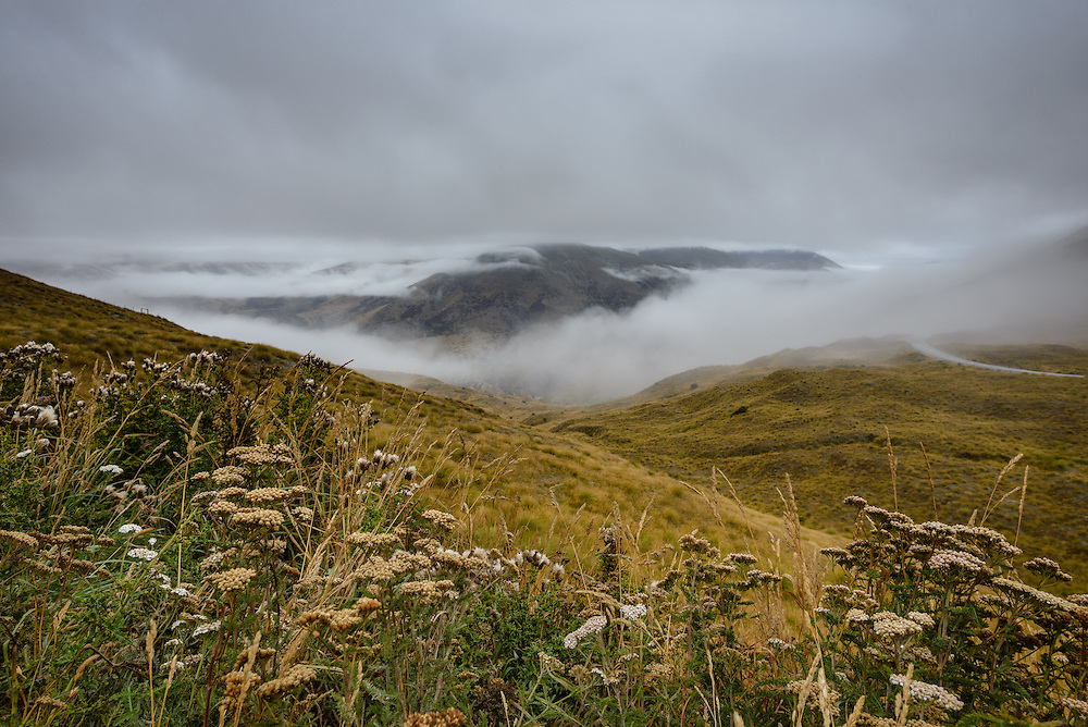 Mountain peaks covered in fog outside Cardona, New Zealand