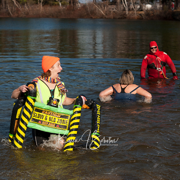 "There was nothing ""slow"" about Miriam Simmons/Meredith Village Savings Bank as she came out of Lake Opechee after her swim during the 7th annual Salvation Army Turkey Plunge Saturday afternoon.   (Karen Bobotas/for the Laconia Daily Sun)"