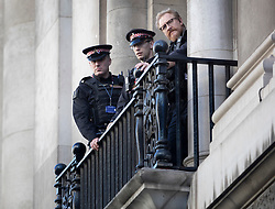 © Licensed to London News Pictures . 27/09/2018. London, UK. Police look on from a balcony as former EDL leader Tommy Robinson (real name Stephen Yaxley-Lennon ) enters the Old Bailey, where he faces a retrial for Contempt of Court following his actions outside Leeds Crown Court in May 2018 . Robinson was already serving a suspended sentence for the same offence when convicted in May and served time in jail as a consequence , but the newer conviction was quashed by the Court of Appeal and a retrial ordered . Photo credit: Peter Macdiarmid/LNP