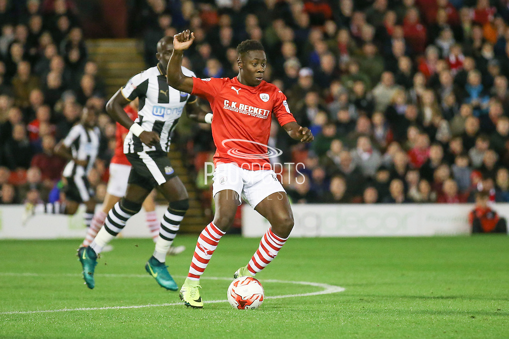 Barnsley midfielder Andy Yiadom (17)  during the EFL Sky Bet Championship match between Barnsley and Newcastle United at Oakwell, Barnsley, England on 18 October 2016. Photo by Simon Davies.