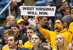 A West Virginia student holds up a sign after beating the Texas Longhorns at the WVU Coliseum.
