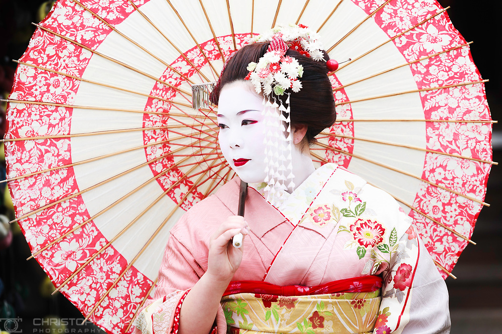 A woman dressed as a Geisha, Kyoto, Japan.<br /> Picture date: Friday April 17, 2009.<br /> Photograph by Christopher Ison &copy;<br /> 07544044177<br /> chris@christopherison.com<br /> www.christopherison.com