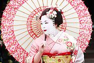 A woman dressed as a Geisha, Kyoto, Japan.<br /> Picture date: Friday April 17, 2009.<br /> Photograph by Christopher Ison &copy;<br /> 07544044177<br /> chris@christopherison.com<br /> www.christopherison.com