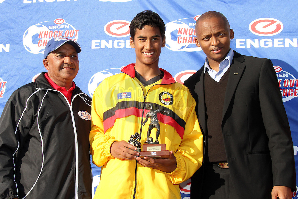 Matthew Johns of Engen Santos receives the Striker of the Tournament Award from Mervin Natus (Selector) and Eric Gum SAFA during the Final on the final day of the Engen Knock Out Challenge held at Stephen Reagan Sports Ground, Mitchells Plain in Cape Town on the 30th September 2012..Photo by Shaun Roy/ SPORTZPICS..