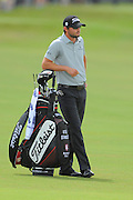 Kyle Stanley stands with his bag during the first round of the World Golf Championship Cadillac Championship on the TPC Blue Monster Course at Doral Golf Resort And Spa on March 8, 2012 in Doral, Fla. ..©2012 Scott A. Miller.