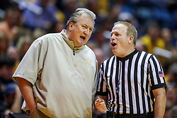 Dec 30, 2018; Morgantown, WV, USA; West Virginia Mountaineers head coach Bob Huggins talks with a referee during the second half against the Lehigh Mountain Hawks at WVU Coliseum. Mandatory Credit: Ben Queen-USA TODAY Sports