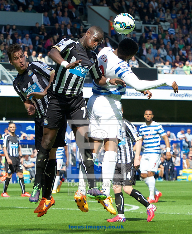 Moussa Sissoko of Newcastle United wins the header during the Barclays Premier League match at the Loftus Road Stadium, London<br /> Picture by Alan Stanford/Focus Images Ltd +44 7915 056117<br /> 16/05/2015