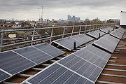 Brixton Energy Solar has installed several hundred square metres of solar panels on the roof of Elmore House in the Loughborough Estate in Brixton.<br /> Re-powering London, empower London communities to create their own renewable energy projects. London. UK