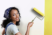 Woman Painting Wall Yellow