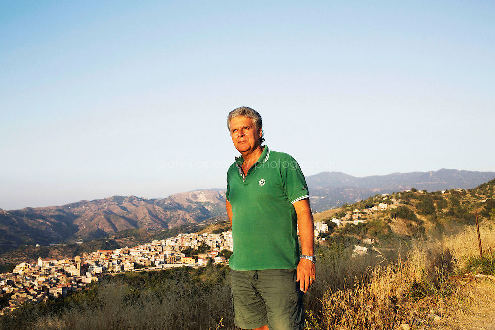 SAN PIER NICETO, ITALY - 3 August 2013: Mario Italiano, 59, is here in Contrada O' Feo, above San Pier Niceto, in the province of Messina, Sicily, Italy, on August 3rd 2013.