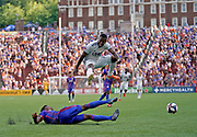 New England Revolution forward Cristian Penilla (70) leaps over FC Cincinnati defender Alvas Powell (92) while going for the ball during a MLS soccer game, Sunday, July 21, 2019, in Cincinnati, OH. The Revolution defeated FC Cincinnati 2-0.(Jason Whitman/Image of Sport)
